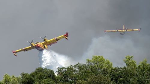 Canadair CL 415 aircrafts drop water to extinguish a forest fire in Gonfaron, France, today