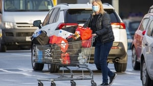 A woman pushes a shopping trolley with her messages in Christchurch as New Zealand went into a snap nationwide lockdown this week. Photo: Getty Images