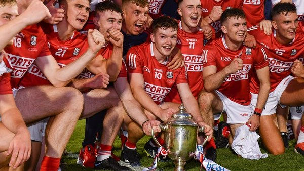 Cork players celebrate with the trophy