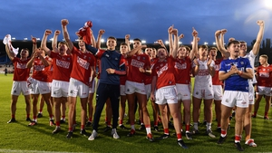 Cork Under-20 players celebrate as captain Cormac O'Brien lifts the cup