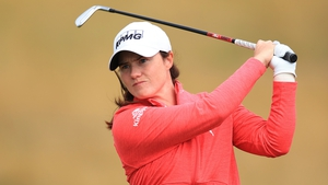 Leona Maguire playing her second shot on the first hole