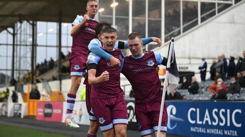 Mark Doyle (R), celebrates with Drogheda United team-mates Jake Hyland (L), Darragh Markey (hidden) Killian Phillips