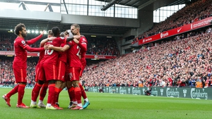 Liverpool celebrate Jota's first-half headed goal
