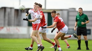 Ronan Fox of Tyrone in action against Colm Gillespie and Hugh O'Connor of Cork