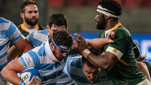 Argentina's hooker and captain Julian Montoya (L) is tackled by South Africa's blindside flanker and captain Siya Kolisi (R) on Saturday