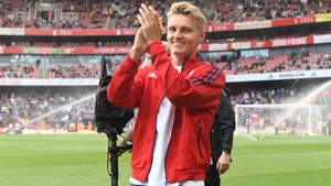 Odegaard applauds the Arsenal fans before the match against Chelsea on Sunday