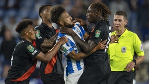 Everton's Moise Kean was sent off after grabbing Sorba Thomas of Huddersfield Town