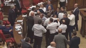 A member of the ruling party tried to kick the opposition politician, sparking mass fighting on the chamber's floor (Pic: Radio Free Europe)