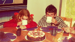 Getty Image: Vintage image of a boy and a girl drinking hot chocolate with a table