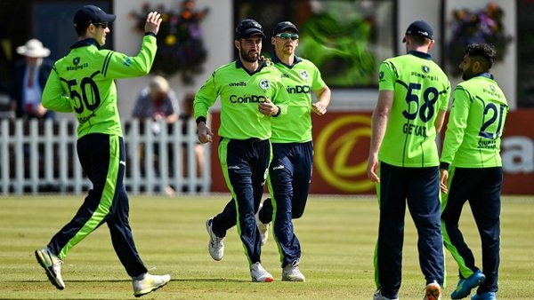 Andrew Balbirnie is congratulated by team-mates after catching Zimbabwe's Craig Ervine