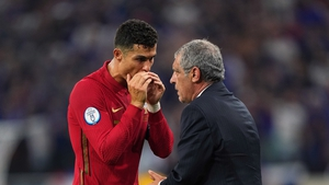 Cristiano Ronaldo talks with Fernando Santos during Portugal's 2-2 draw with France at Euro 2020