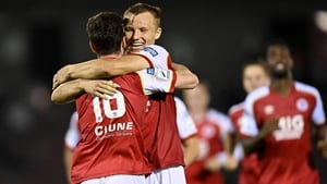 Alfie Lewis (16) ocelebrates with team-mate Jamie Lennon after scoring the decisive penalty
