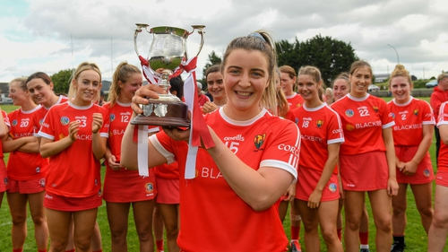 Linda Collins with the Munster Camogie trophy affter this year's win over Limerick