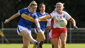 Aisling McCarthy of Tipperary gets her shot away as Tyrone's Aiobhinn McHugh closes in.