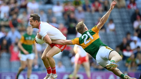 Kieran McGeary gets out in front of Tommy Walsh