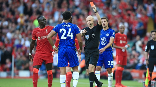 Referee Anthony Taylor shows the red card and sends off Reece James