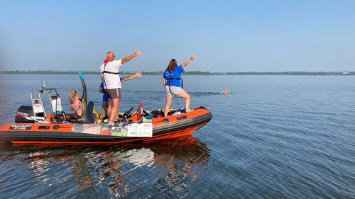 The support boat guiding Francie McAlinden to finish line