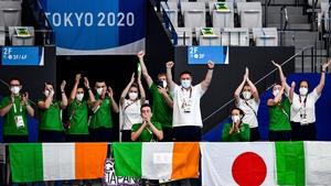 Members of Team Ireland cheer on Nicole Turner