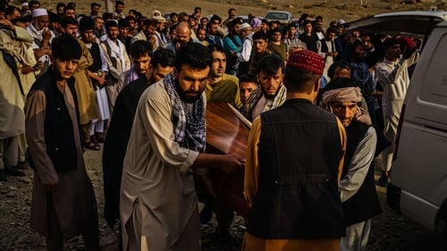 Relatives attend a mass funeral for members of a family killed in the drone airstrike in Kabul