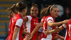 Nikita Parris celebrates with Katie McCabe (r) and other Arsenal team-mates after scoring the first goal