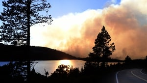 The sun sets over the Caldor Fire in the El Dorado National Forest in South Lake Tahoe, California