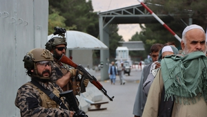 Taliban fighters stand guard outside the Hamid Karzai International Airport