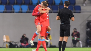 Enes Mahmutovic and Dirk Carlson of Luxembourg celebrate at full-time