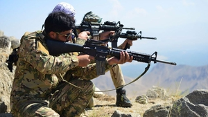 Anti-Taliban forces take positions as they patrol a hilltop in the Darband area of Panjshir province