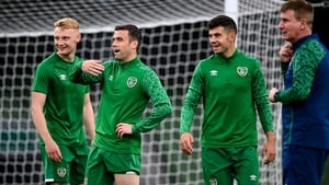 Latest call-up Liam Scales, captain Seamus Coleman and John Egan share a joke as Stephen Kenny looks on during a training session