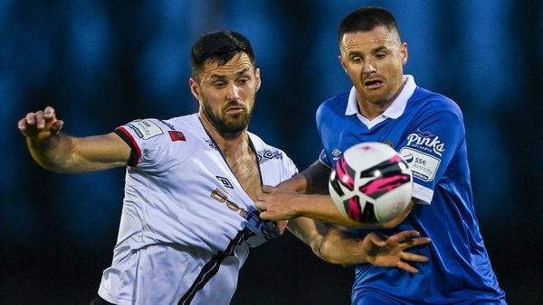 Dundalk's Patrick Hoban and Eddie Nolan of Waterford FC battle for possession