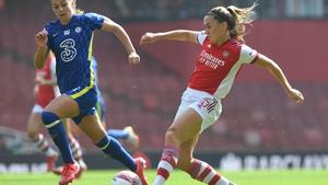 Katie McCabe works the ball past Chelsea's Melanie Leupolz
