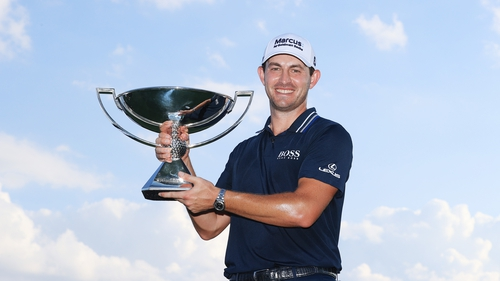 Patrick Cantlay with the FedEx Cup trophy and $15m in his pocket