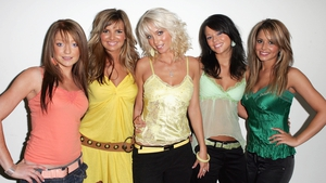 Sarah Harding, centre, pictured with her Girls Aloud bandmates in 2004