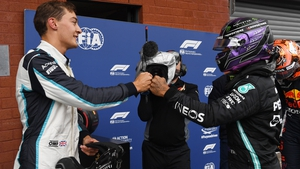George Russell (L) and Lewis Hamilton greet each other after qualifying at the Grand Prix of Belgium last month