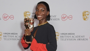 Michaela Coel pictured with the best actress award for I May Destroy You at the 2021 BAFTAs