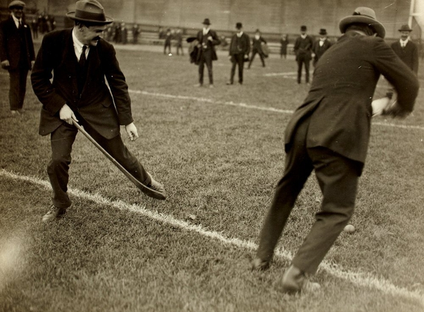 Century Ireland Issue 213 - Michael Collins and Harry Boland playing hurling on the pitch at Croke Park, on the day of the Leinster Hurling Final Photo: National Library of Ireland, BEA46