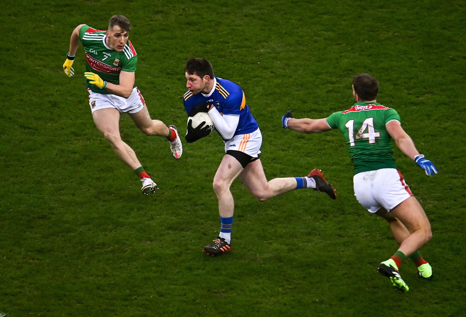 Image - Tipp's Jimmy Feehan bursts past Eoghan McLaughlin and Aidan O'Shea during the 2020 semi-final