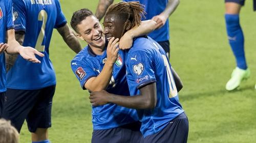 Goalscorers Giacomo Raspadori and Moise Kean celebrate during Italy's 5-0 win in Reggio Emilia