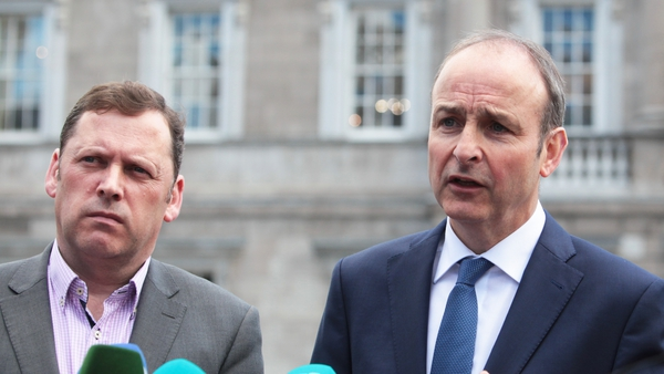 Barry Cowen (l) was sacked from his role as Minister for Agriculture by Taoiseach Micheál Martin (r) just over a year ago (via Rollingnews.ie)