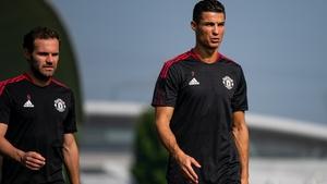 Ronaldo (R) pictured at training with Juan Mata this week