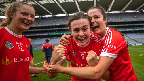 Ciara O Sullivan (L), Hannah Looney (C) and Fiona Keating celebrate after beating Kilkenny in the All-Ireland semi-final