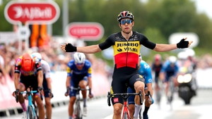 Wout Van Aert celebrates after crossing the line