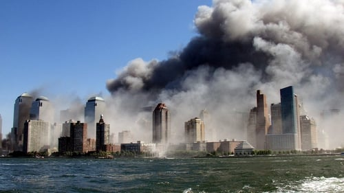Smoke rises over the Manhattan skyline after two planes hit the Twin Towers