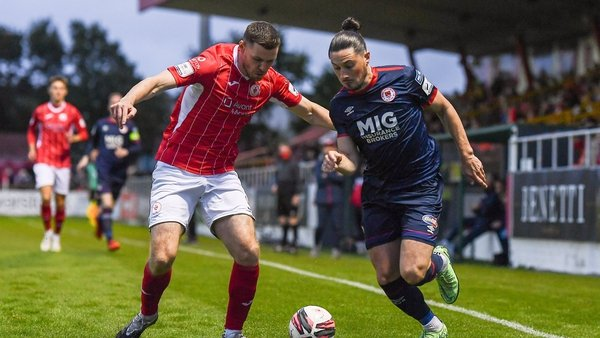 Ronan Coughlan of St Patrick's Athletic in action against Garry Buckley of Sligo Rovers