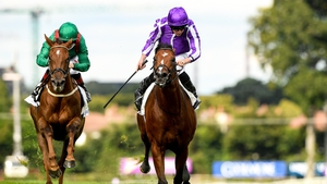 St Mark's Basilica, right, with Ryan Moore up, on their way to winning the Irish Champion Stakes from second place Tarnawa