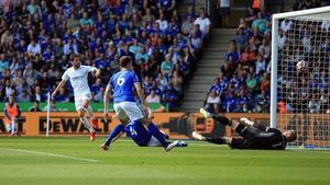 Bernardo Silva (L) scores past Leicester City goalkeeper Kasper Schmeichel (R)