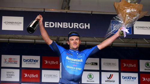 Yves Lampaert celebrates on the podium
