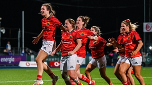 Munster players including Alana McInerney and Nicole Cronin celebrate after the match