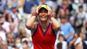Emma Raducanu celebrates winning match point