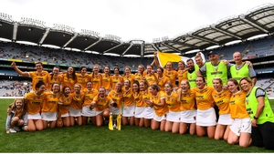 Antrim players and management rejoice on the Croke Park turf